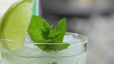 Glass Of Mojito Cocktail With Fresh Mint And Lime ビデオ