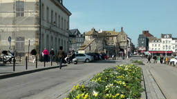 Europe France Normandy fishing village of Honfleur 002 flowers in the street Footage