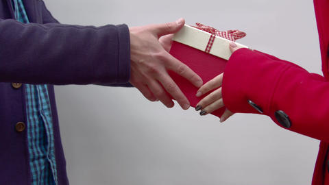 Men's hands give a gift to women Footage
