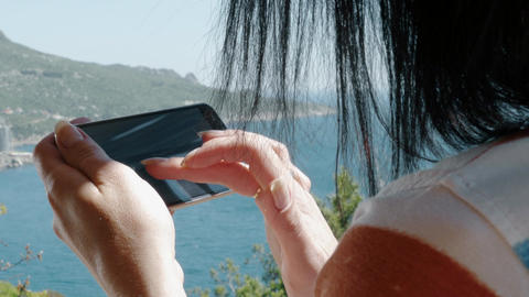 Woman Use A Smart Phone Mobile Technologies In Nature Filmmaterial