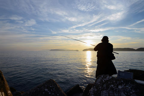 An angler and the Japanese sea Photo