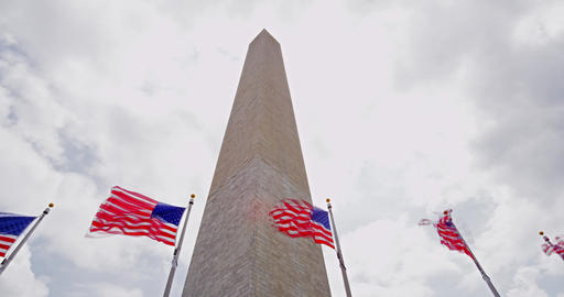 Washington monument with flags timelapse and rolling clouds 영상물