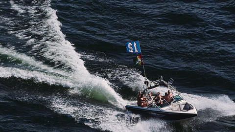 Boat on lake with seahawks flag Image