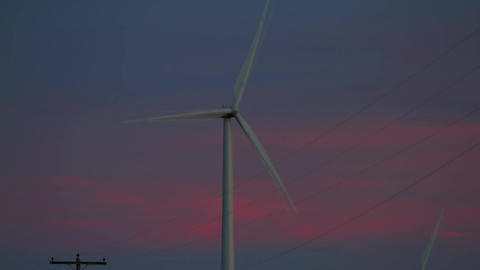 Lone propeller Wind Farm detail with purple clouds Footage