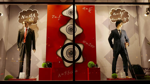 4K Ungraded: Men's Mannequins in Business Suits Stand in Shop Window With Footage