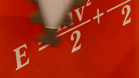 4K Ungraded: Flywheel Blades Rotate Against Background of Red Wall With Footage