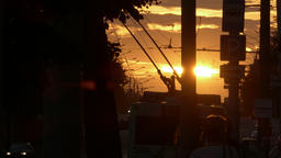4K Ungraded: Trolleybus Crosses Frame Against Sunset Revealing Picturesque Footage