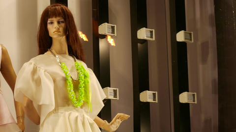 4K Ungraded: Female Mannequins in Designer Clothes Are in Shop Window Next Footage