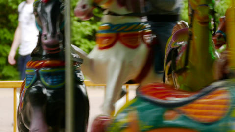 4K Ungraded: Children's Merry-Go-Round Carousel With Colorful Wooden Horses Footage