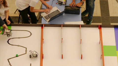 4K Ungraded: Participants in Youth Robotics Competition Prepare and Set Up Live Action
