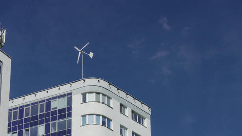 4K Ungraded: Wind Turbine on Roof of Office Building in City Footage