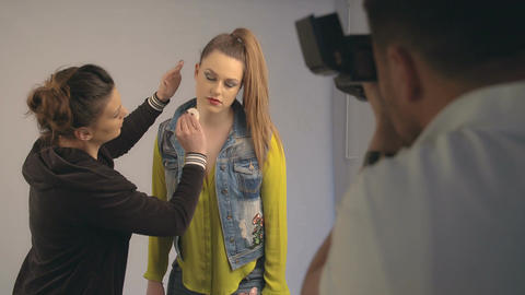 Fashion photo shoot with photographer and beautiful female model Live Action
