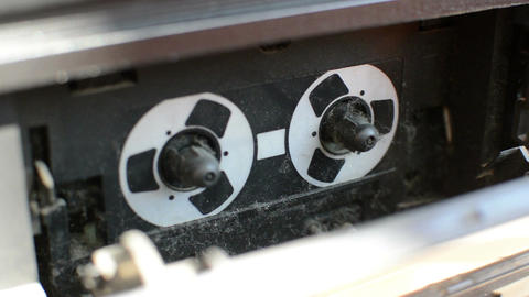 Man's hand inserting the audio cassette into the retro tape player full with dus Footage