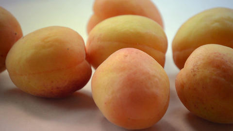 Apricot. Fresh and Ripe Organic Apricots on the table. Bio Fruits Live Action