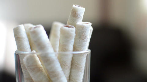 Wafer Sticks With Cream standing in glass and rotate Footage