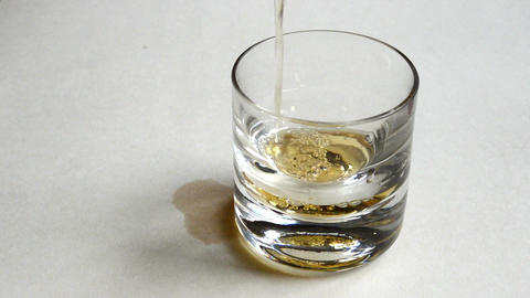 Pouring whiskey in glass Footage
