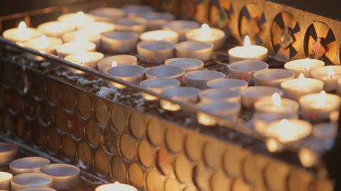 Detailed Shot of Burning Candles in the Church Filmmaterial