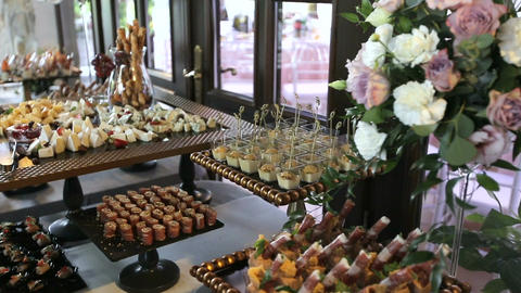 Beautifully decorated catering banquet table with different food snacks and appe