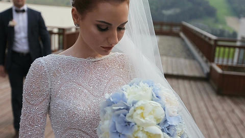 Beautiful wedding couple in mountains. Young beautiful... Stock Video Footage