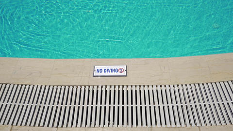 Outdoor swimming pool with no diving sign Footage