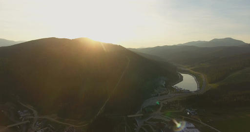 Aerial View. Flying over the beautiful mountains in sunset. Aerial camera shot Footage