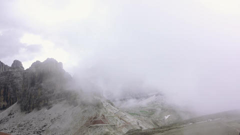Quick Fog in the Rocks of the Dolomites. Fast Motion Footage