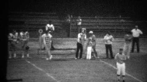 1978: High school football night game 3rd down sign on sidelines Footage