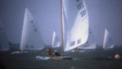 1979: Sailboating rail boat tacking across win switching sail direction Footage