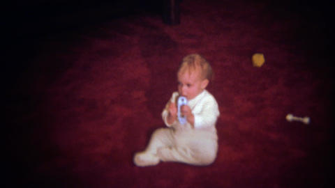 1979: Seemingly happy baby cries for no obvious reason Footage