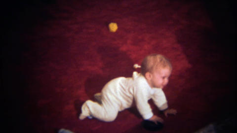 1979: Crying baby crawls away hiding behind living room couch Footage