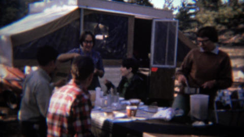 1971: Family having dinner at popup camper outdoor campsite Footage