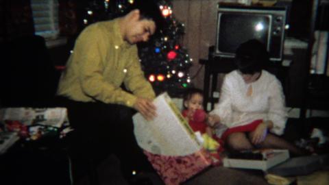 1971: Man gets slide sorter Christmas gag gift Footage