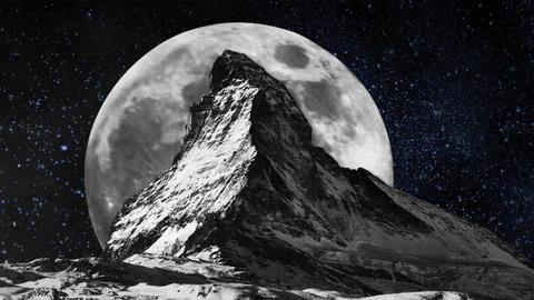 Matterhorn Mountain Top with a Full Moon Rising in Timelapse Footage