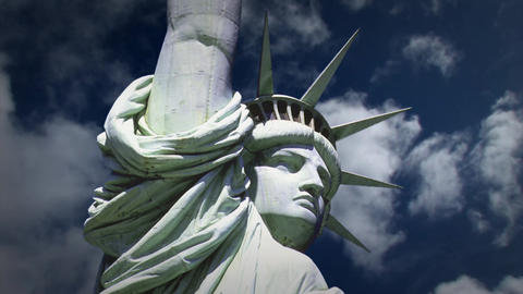 Statue of Liberty with Background Clouds in Time Lapse Footage