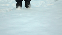 Feet jump in snow close slow motion shot. touch down to shallow snowdrift Footage