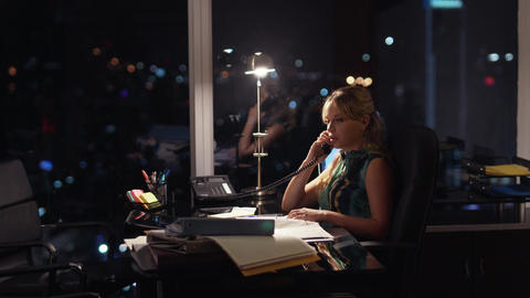 5 Businesswoman Working Late At Night Answering Phone Call Footage