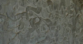 Bas relief stone carving Angkor Wat Cambodia ancient Khmer civilization Footage