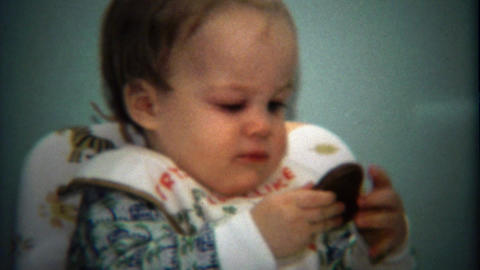 1974: Baby Opening Red Chocolate Valentines Day Heart Gift stock footage