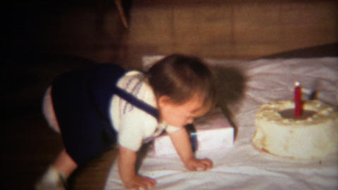 1971: Birthday party for 1 year old with big cake and giant candle Footage