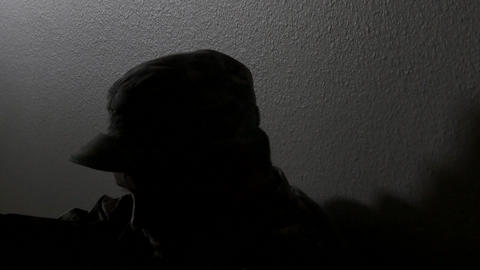 Closeup of a soldier's head while sitting in the hallway battling depression, 4K Footage