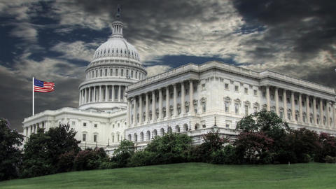 Capitol Building Washington DC With Waving Flag In The Background stock footage