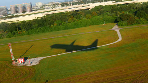 Aerial Plane shadow taking off from Florida Airport Footage