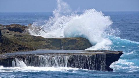 Sea waves break of the rocky shore Footage