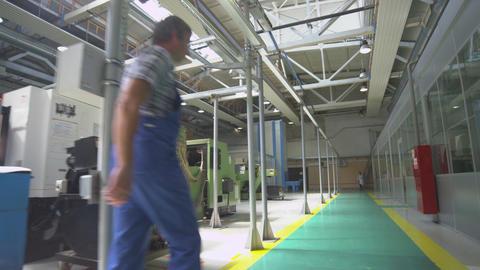 Camera Removes Fast along Modern Workshop Footage