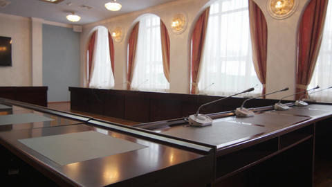 Camera Shows Conference Table against Large Windows Footage