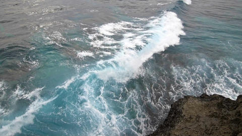 Sea waves explode on the rocky shore Footage