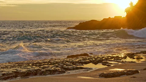 Sea waves and rocky shore at sunset Footage
