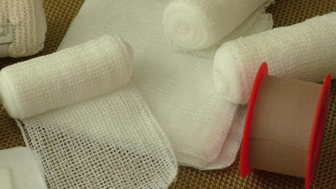 Bandages and plasters on a gold background Footage