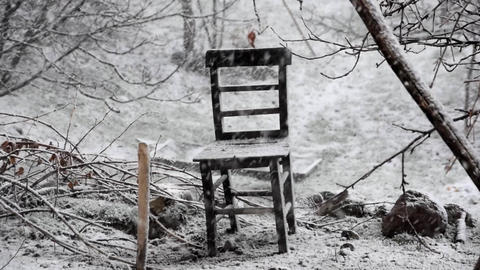 Heavy snow outdoor and alone old wooden chair Footage