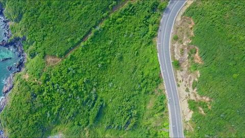 Aerial View Highway Curves Sharply around Hills Footage